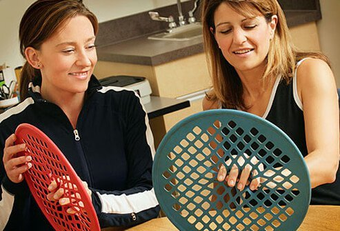 Photo of occupational therapist and patient.