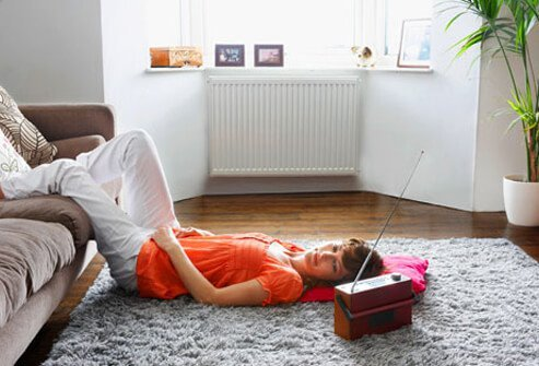A woman rests with her feet elevated after an injury.