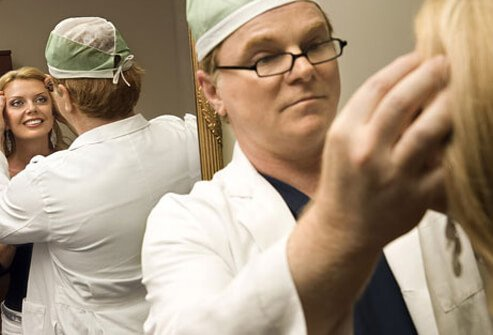 A surgeon consulting with a cosmetic surgery patient.