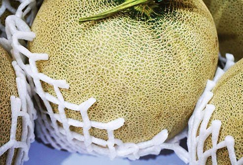 Even though you aren't going to eat the rind of this melon, you should give it a good scrub with a produce brush before you slice into it.