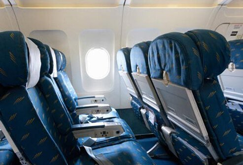 Photo of empty airline cabin seats.