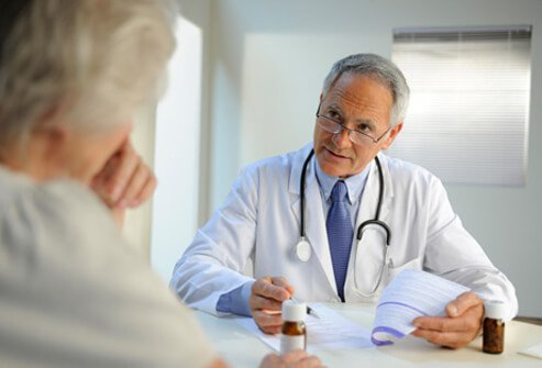 A doctor prescribing medication to a dementia patient.