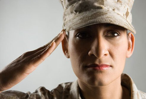 Photo of a soldier saluting.