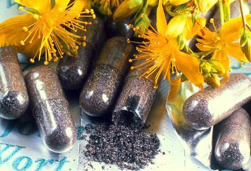 Pills and flowers of St. John's wort, an herbal remedy that may help treat mild depression.