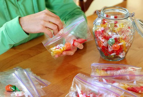 Put a few glucose tablets, or five or six pieces of hard candy, into baggies.