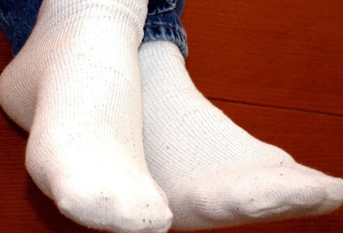 Wear socks or stockings and proper shoes at all times.