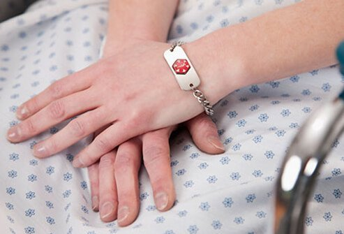 A close up of a diabetic medical ID bracelet on a wrist.