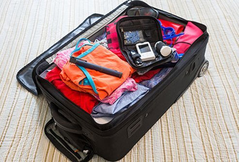 A carry on suitcase complete with diabetic testing supplies.