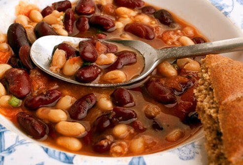 A photo of bean soup with bread.