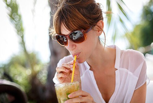 A woman sipping on a tasty drink.