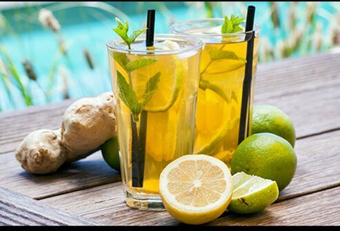 Glasses of ginger ale with citrus garnish.