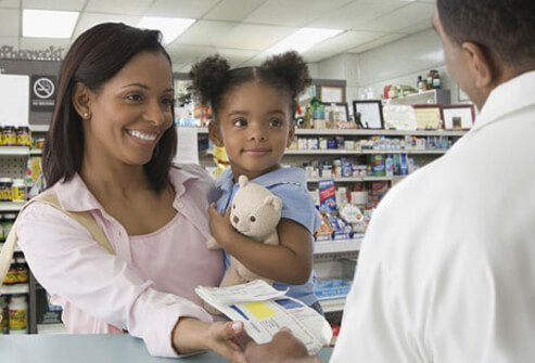 A mother and child at the pharmacy.