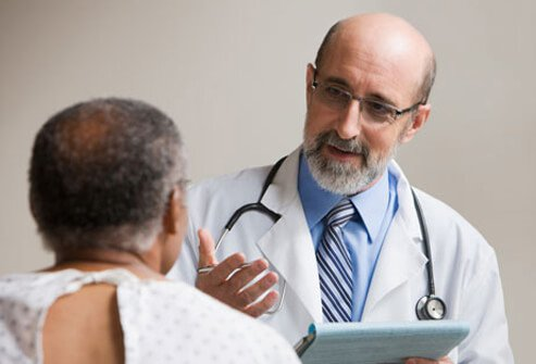 Photo of a man speaking with doctor about erectile dysfunction.