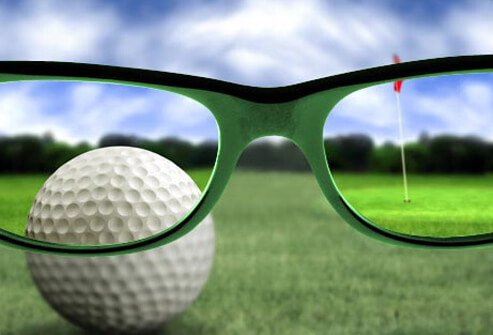 Photo of glasses on golf course.