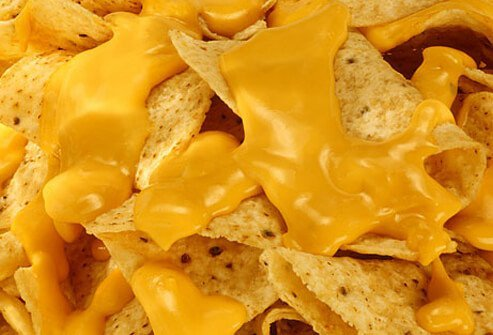 Corn chips covered in nacho cheese.