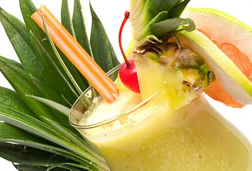 A blended piña colada garnished with pineapple and a cherry.