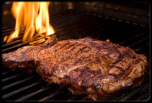 Steak being cooked on grill.