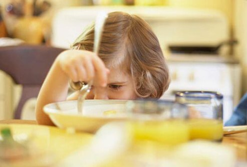 If your child is pushing food around on her plate, she may be full.