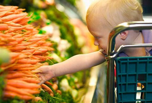 Many children warm up to veggies when they've helped pick them out, whether at the store or at meals.