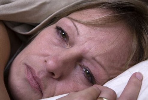 A woman suffering fatigue, a common symptom of fibromyalgia.