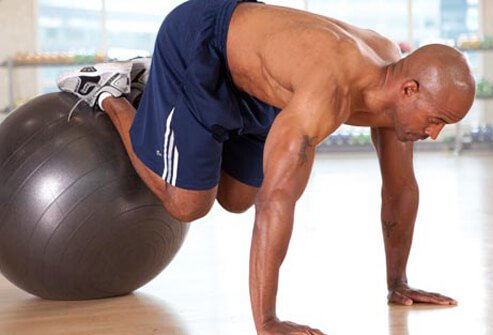 This move starts with your stomach on a stability ball, hands and feet on the floor.