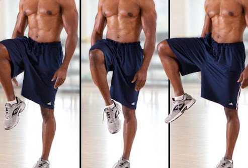Stand with your arms at your sides, feet hip-width apart.