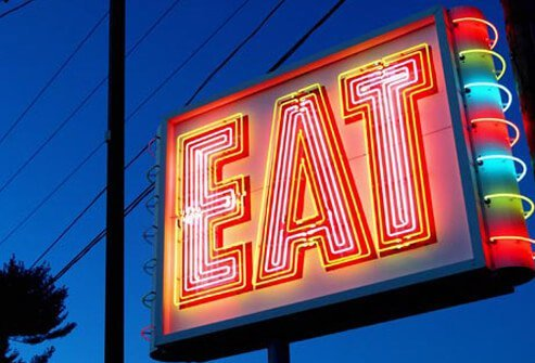 Photo of neon eat sign.