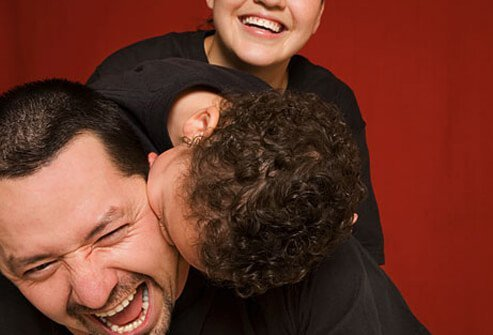 Photo of man laughing with son.