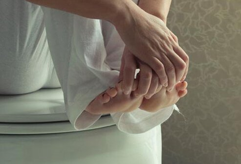 Photo of woman touching toes.