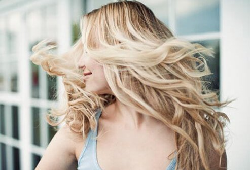 Blonde hair with dark roots is trendy, but hard to pull off.
