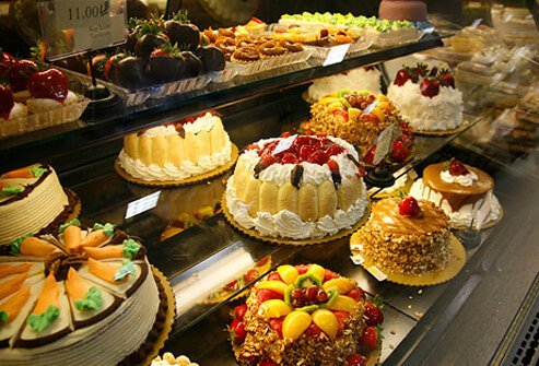 Bakery display of cakes, pies, cookies, and treats.