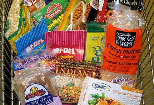 A variety of gluten-free products in a grocery cart.