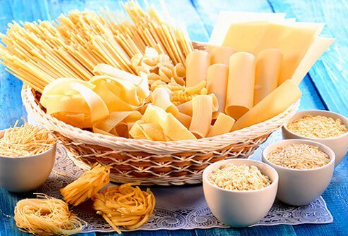 Basket and bowls of differenty types of gluten-free pasta.