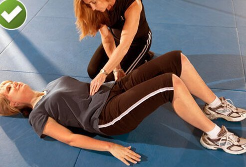 Before back pain has you writhing on the floor with the usual symptoms, try lying on your back for some pelvic tilts.