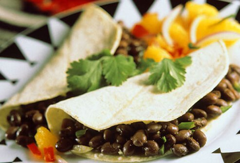 At Mexican eateries, dining out is a party. But beware the lard and cheese.