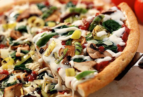 A photo of a vegetarian pizza.