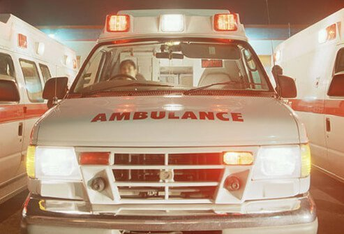 A photo of an ambulance transporting someone who is experiencing a heart attack.