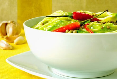 A bowl of pasta with peppers.