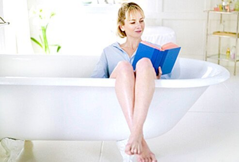 A woman soaks in a sitz bath to treat her hemorrhoids.