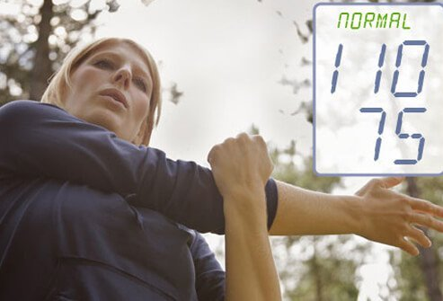 Photo of woman stretching after a workout indicating a normal blood pressure level.