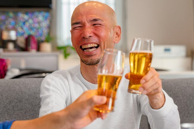 Some people lack a working enzyme to break down alcohol, so they may get rosy cheeks from drinking.