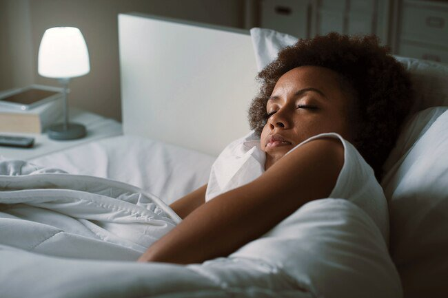 Sleeping in separate beds may help you stay cooler at night.