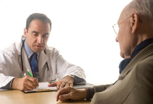 Doctor discussing hyperthyroidism treatment with a patient.