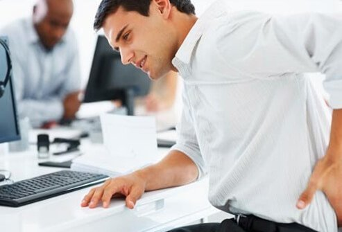 An office worker has lower back pain.