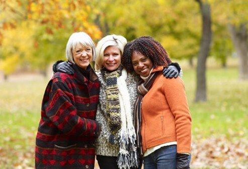 A group of three mature women, experiencing menopause.