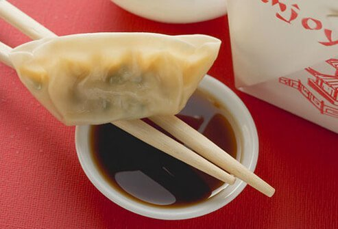 A Chinese dumpling with soy sauce.