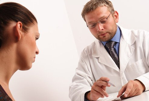 A doctor consults with a patient.