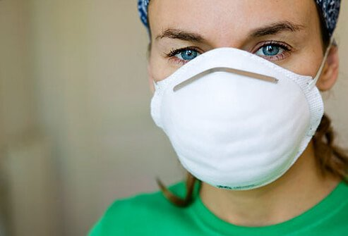 A woman wearing a dust mask.