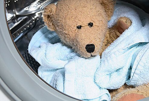 Photo of teddy bear in the wash dryer.