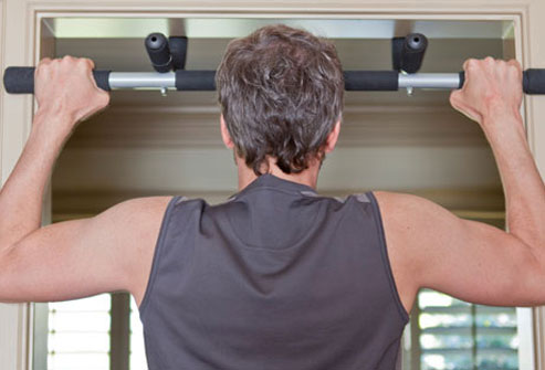 Pull-ups work arm and back muscles, giving you great bang for your buck.